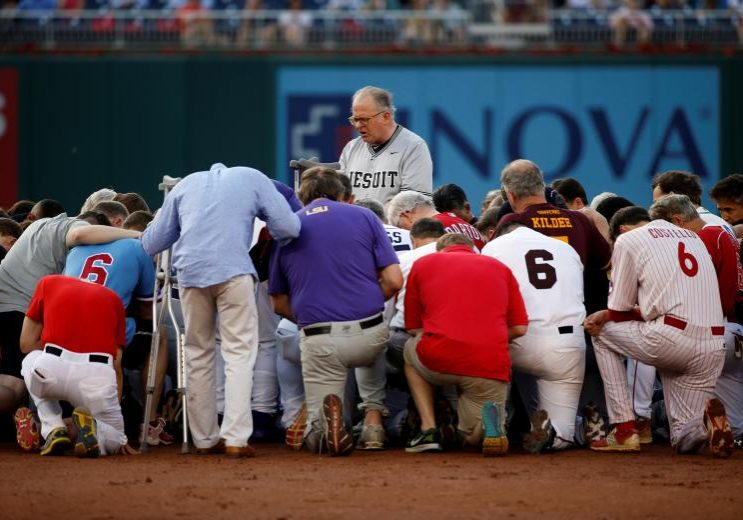 Patrick Conroy, Chaplain of the House of Representatives, leads Democrats and Republicans in prayer before they face off in the annual Congressional Baseball Game at Nationals Park in Washington. Members of Congress took the field for their traditional Republicans vs. Democrats baseball game, with many wearing hats to honor Representative Steve Scalise, who was critically wounded by a gunman as his Republican team practiced a day before.  REUTERS/Joshua Roberts