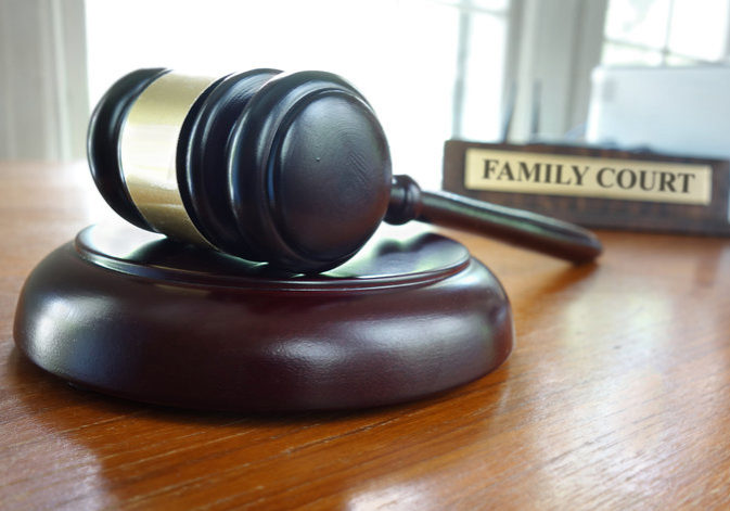 Judge's legal gavel on a desk with Family Court nameplate in the background